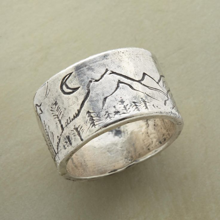 STEWART FALLS RING--Inspired by a hike near the Sundance Resort, Jes MaHarry hand etched this sterling silver band with a beautiful mountain scene. Spin it around and take a journey. USA. Exclusive. Whole sizes 5 to 9.