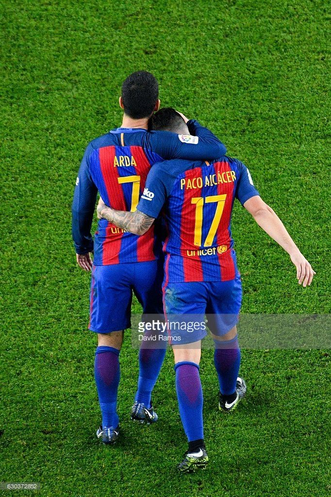Paco Alcacer of FC Barcelona celebrates with his team mate Ardan Turan after scoring his team's fifth goal during the Copa del Rey round of 32 second leg match between FC Barcelona and Hercules at Camp Nou on December 21, 2016 in Barcelona, Spain.