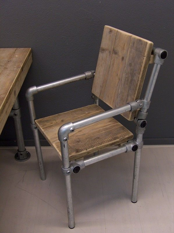 Industrial pipe and wood arm chair would look very nice with our octagonal table. -- from ThisIsNotIkea.com