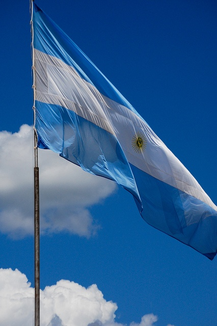 ARGENTINA - flag. The blue represents the elements of vigilance, truth, loyalty, perseverance and justice. The white represents peace and honesty. The sun represents the May Sun.