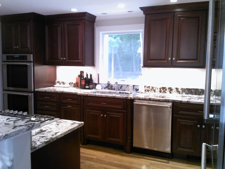 Mahogany stained cherry with delicartus granite kitchen for Mahogany kitchen designs