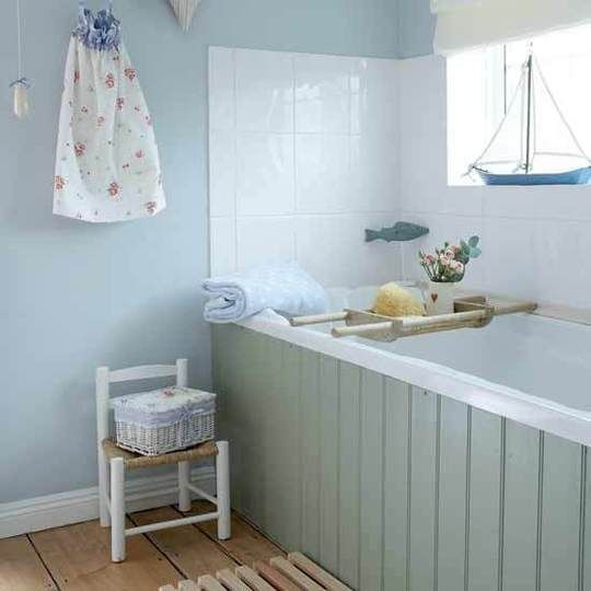 Love this chic grey/blue. Amazing how to wooden panel around the bath makes this bathroom looks so much more amazing.