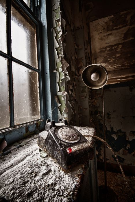 Phone in an abandoned room... neglected and forgotten.