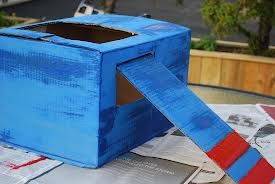 Use a cardboard box like this as a plane costume. Goes with recycled theme and child like theme