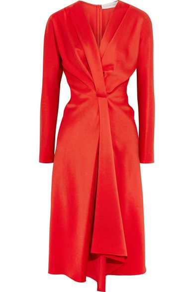 Victoria Beckham's dress is a striking red alternative to classic black styles, and equally as versatile. Cut from vivid satin-crepe, this lustrous piece cinches in at the waist, then cascades to a draped panel to create beautiful movement. We like it best with pristine white pumps, but it will work equally well with metallic or black.
