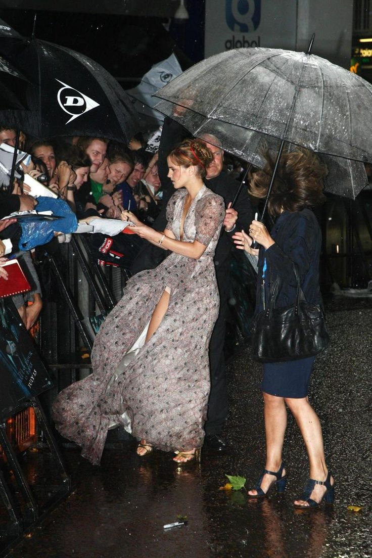 This gorgeously captured moment is a perfect example of how, without trying, a candid photograph can be art. Emma Watson is wind swept, lost amoungst the rain, but still a delicate, beautiful figur...
