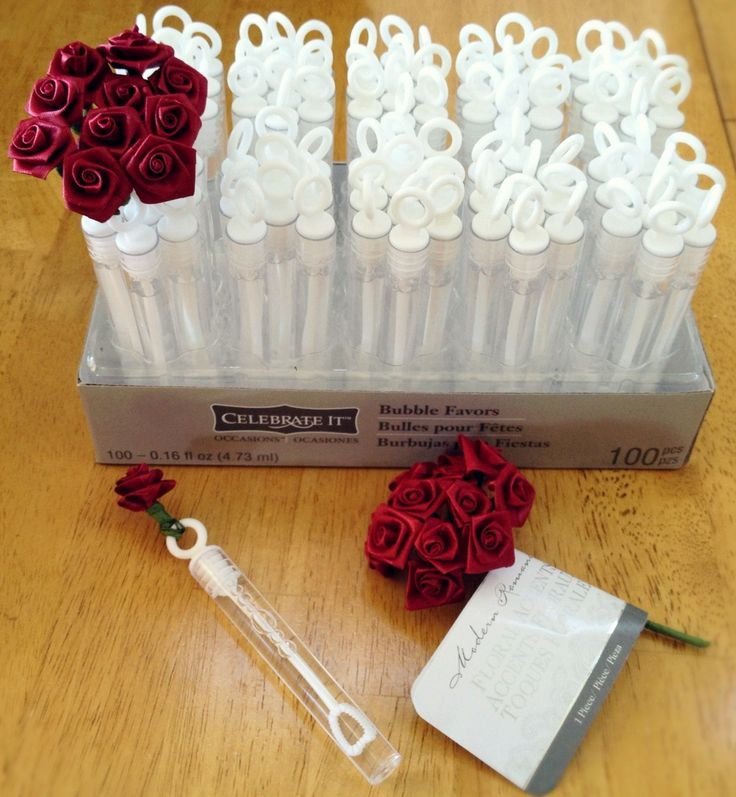 Bubble Tube Rose Bouquet--Wrap ribbon roses around the tops of bubble wands, both from Michael's Crafts.