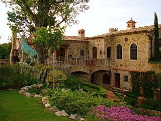 Large farmhouse built on an old sixteenth-century water mill. Masía Cassà de la Selva, Spain
