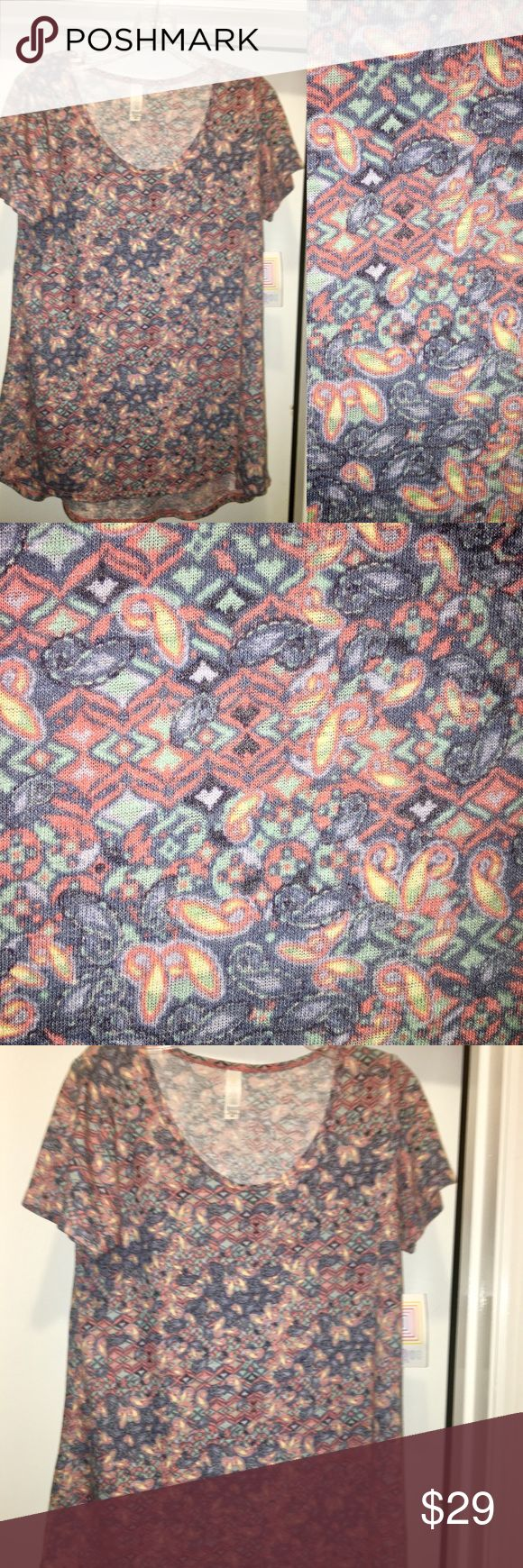 LulaRoe XS Classic T NWT This T has light weight fabric with a linen/textured feel. It is not pilled, that's the textile weave. The detailed floral/geometric mixed pattern is in beautiful shades of rose, denim blue, mint, pale yellow, and pale purple.  Hypoallergenic/friendly home 🚭  LulaRoe Classic T is a wardrobe staple. Can be tucked in a skirt/slacks or casual with jeans/leggings/shorts. Soft breathable fabric, roomy short sleeve, high scoop neckline, slight tailored torso, loose at the…
