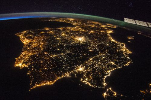 July 26, 2014 — The Iberian Peninsula lights up the night, as seen from the International Space Station. Beyond Spain and Portugal, we can also see France, Morocco, and (probably) Andorra. (NASA)