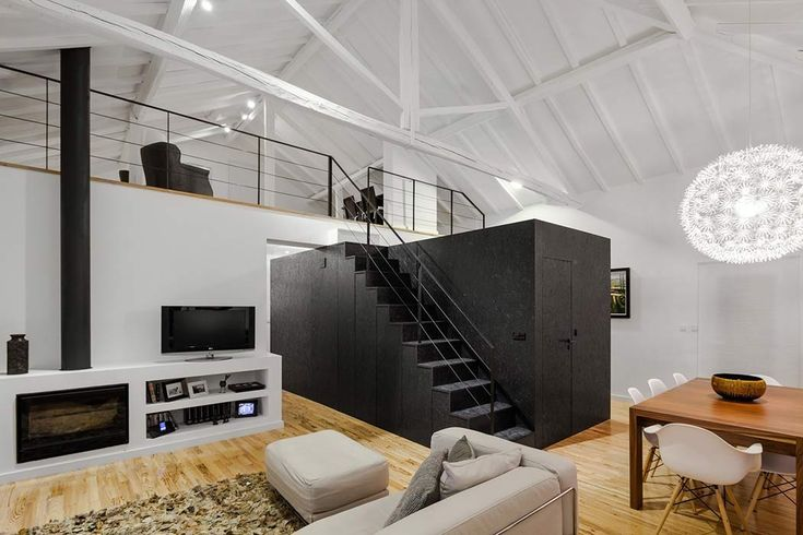 "This Portugal remodel features a huge central ""black box""; this focal point serves as not only an aesthetic highlight, but also a multi-functional space."