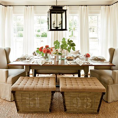 Set Up a Combination of Seating Arrangements. Give an everyday dining space a casual vibe with a combination of seating arrangements, like the wing chairs, curvy settee, and burlap-topped benches that circle this dining table
