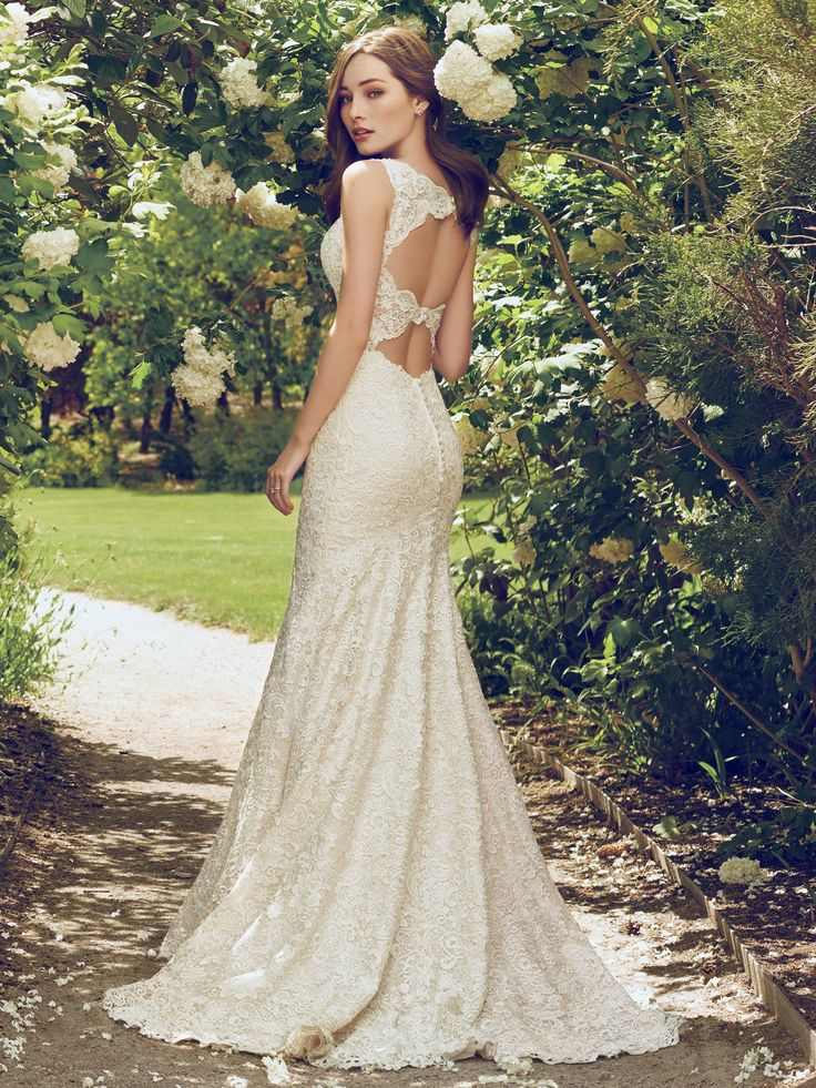 Rebecca Ingram - HOPE, Romantic and vintage-inspired, this allover-lace fit-and-flare features an illusion plunging neckline and scalloped edging. A double-keyhole back adds a touch of alluring elegance. Finished with covered buttons over zipper closure.