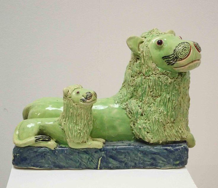 An original ceramic work by Nico Masemlolo #LionAndCub #LionWithCub #GreenCeramic #Ceramic #FineArt #NicoMasemolo #SouthAfricanArt #SouthAfricanArtist For more please visit: www.finearts.co.za