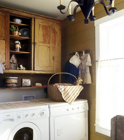 An antique country-themed laundry room.. Chandelier is such a nice touch! Might do this instead...