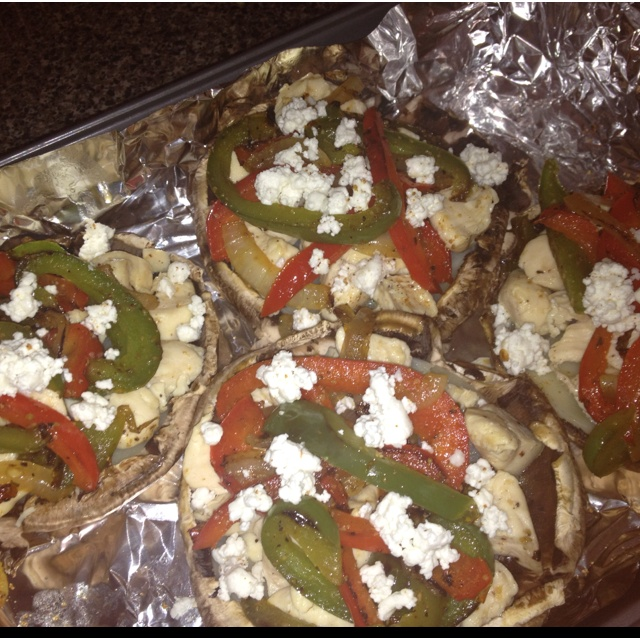 Baked giant stuffed portabella mushrooms. Layers: provolone cheese ...