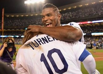 Justin Turner of the Los Angeles Dodgers celebrates with Yasiel Puig after hitting a three-run walk-off home run in the ninth inning to defeat the Chicago Cubs, 4-1, in Game 2 of the National League Championship Series at Dodger Stadium on October 15, 2017 in Los Angeles, California. (Harry How | Getty Images)