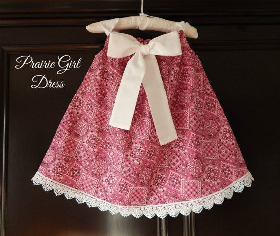 This Sweet Western Lace Dress is the Perfect Gift for a Baby Shower! Dress features an Adorable Pink Bandana Print paired with a Beautiful White Fabric Bow! The neckline has a Front Crisp White Fabric Tie which will make your Cute Baby Girl look even Sweeter! **Approximate lengths