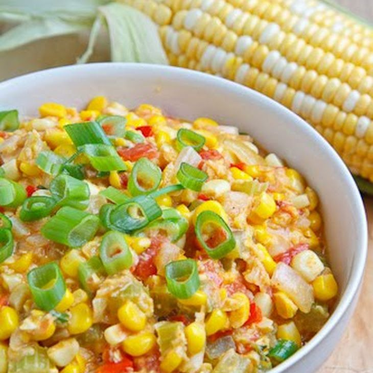Maque Choux Recipe Side Dishes with corn, butter, onions, celery, bell pepper, tomatoes, heavy cream, thyme, sliced green onions, cayenne pepper, salt