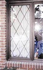 Window Security Bars - Tudor diamonds - custom sizes look like they're available in the $100+ range