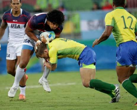 United States back Folau Niua (7) is hit by Brazil back Felipe Claro (4) during a rugby sevens match... - Dan Powers-USA TODAY Sports