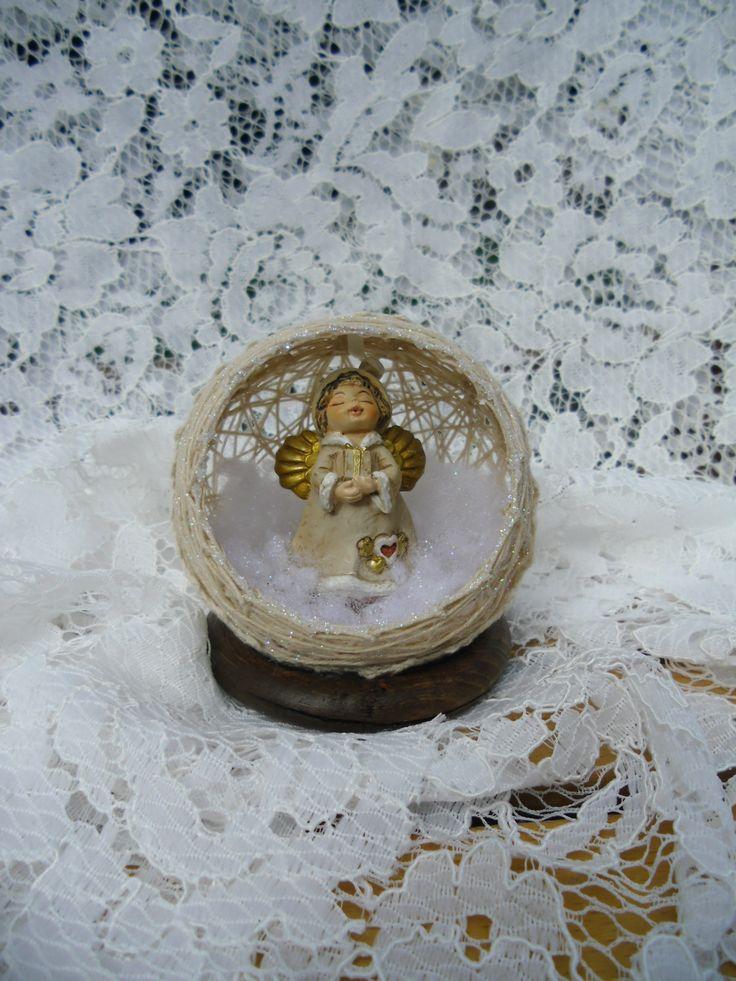 Sfera natalizia di cotone con angelo
