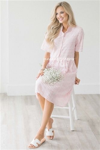 7078926fba How adorable is this new dress! We fell in love with it instantly! This light  pink and ivory striped dress features a button front