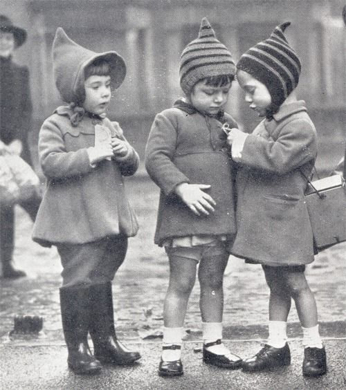 During the Blitz, many children were evacuated out of the cities to safer places in the country, these children here, from East London, seemed to be checking out their curious identification labels.