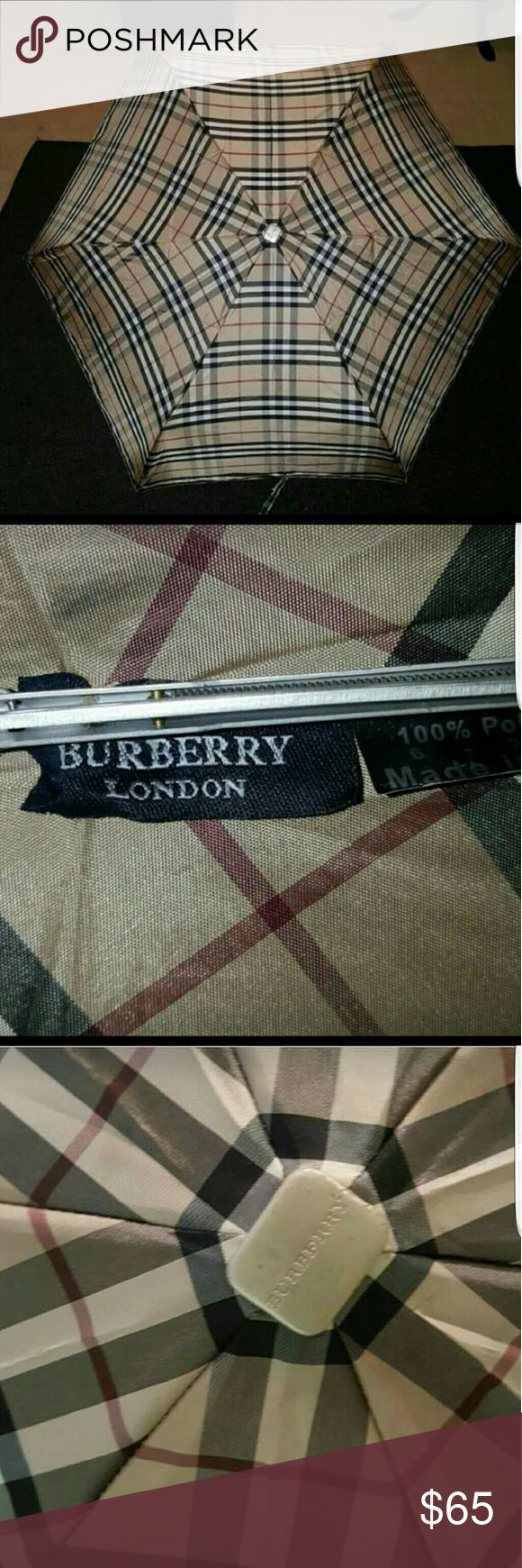 """Burberry Trafalgar Check Small Umbrella Good Condition   Handle shows some wear   Authentic   Good Condition   No Sleeve/Case  Shows wear on handle  Push Button Open   Small enough to fit in handbag (packable)  Appox. 38"""" diameter when open Burberry Accessories Umbrellas"""