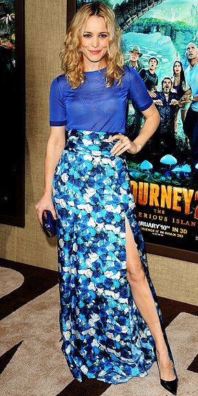 Rachael McAdams in a sheer top and high waisted skirt.