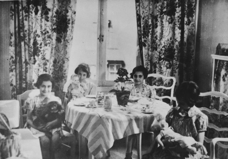Four young girls from Germany, including Anne and Margot Frank, have a tea party with their dolls at the home of Gabrielle Kahn in Amsterdam.  Pictured from left to right are Anne Frank, Ellen Weinberger, Margot Frank and Gabrielle Kahn.