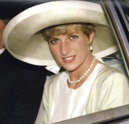 March 1990: The Princess of Wales, wearing a green Catherine Walker suit and Philip Somerville hat, arrives in Lagos, Nigeria, for an official visit, March 1990.