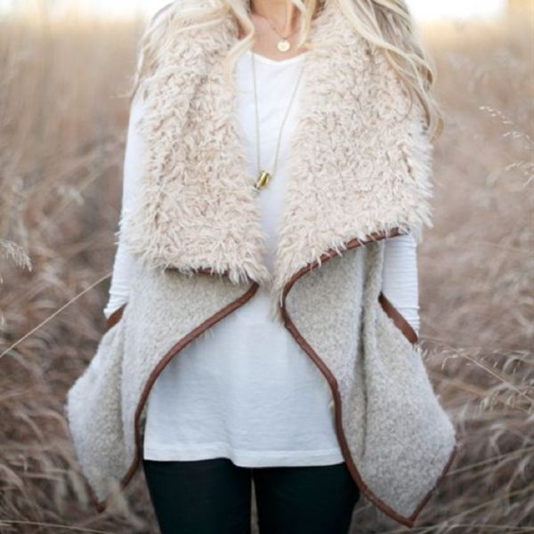 Cozy faux sherpa detail adorns this soft wool blend vest. Features an open front + collar, two functional side pockets, and faux leather trim - color: beige tone ivory + tan - acrylic/wool/polyester b