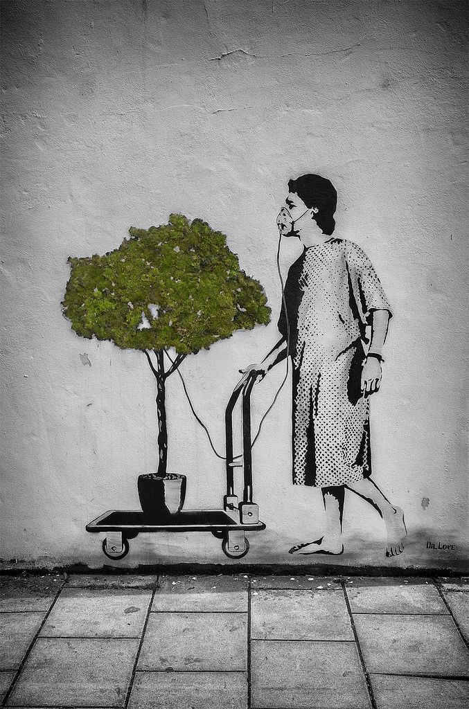 Bristol Upfest 2015 graffiti and street art festival. Graffiti mural of  a patient in bowler hat and smock pushing  a cart with a tree.  Daz smith is a Bath, U.K. based photographer who loves black and white and street photography.  Would you like a print of my work or would you like to licence or use one of my images - why not contact me @ darryl@nethed.com or www.dazsmithphotography.com
