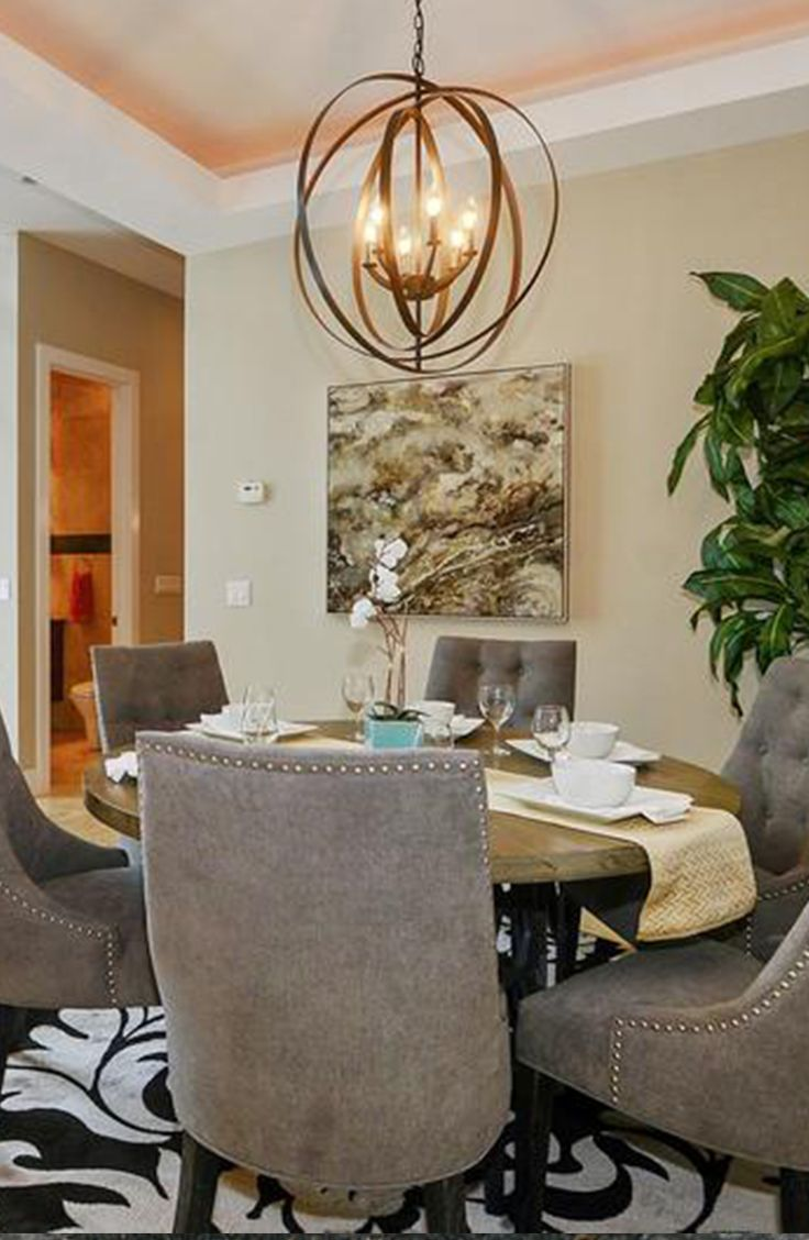 Three-level Bucktown home with dining room complete with caged chandelier and cushioned chairs