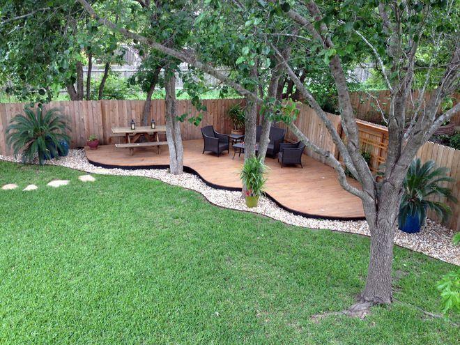 back yard oasis.  beautiful deck and path.
