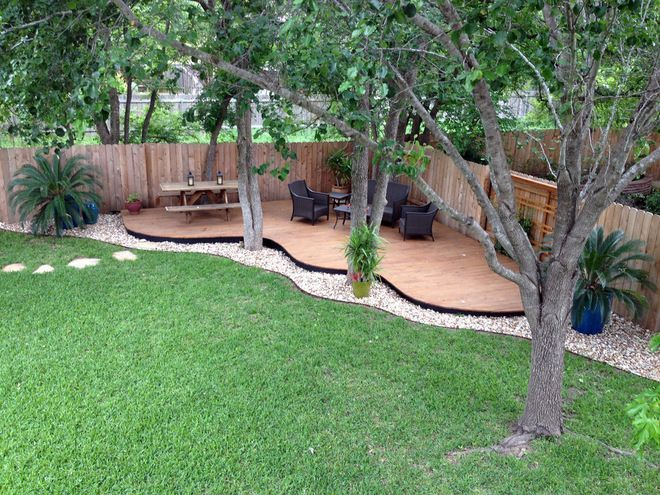 back yard oasis. beautiful deck and path.