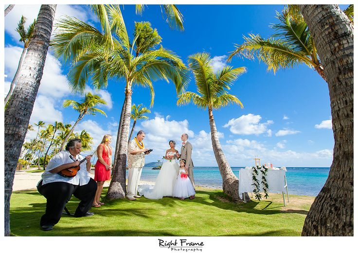 http://www.rightframe.net - Destination wedding on the beautiful Kahala Beach (Waialae Beach Park), Oahu.  Hawaii, photography, photographer, weddings, photos, bride, groom, hawaiian, romantic, ideas, couple, bouquets, lei, palm, tree, Waikiki, honolulu, resort, ceremony.