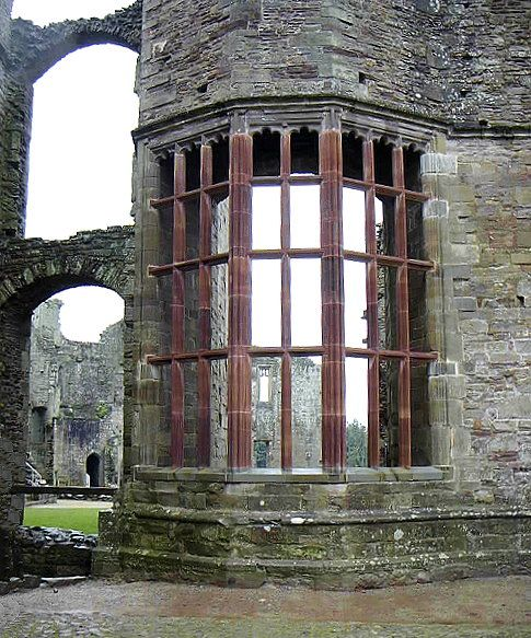 Oval window, Raglan Castle medieval ruins, located in Monmouthshire, Wales.