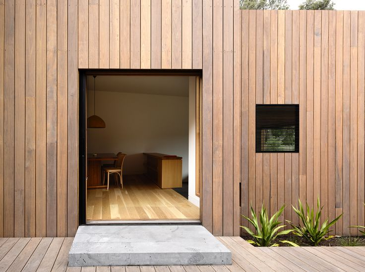 """A timber rain screen made of locally-sourced spotted gum clads the house. """"It's basically like a tortoise shell in that it's a protective layer, a shield, that allows the building to be protected from the sun and insulated from the cold,"""" Kennon says. Because of its high density, the Australian hardwood stands up well against the elements."""