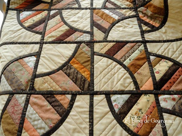 Drunkard's path quilt, quilt as you go. You tube video...not in English, but it's very clear.  Shows how to put quilt as you go blocks together-very clearly done.