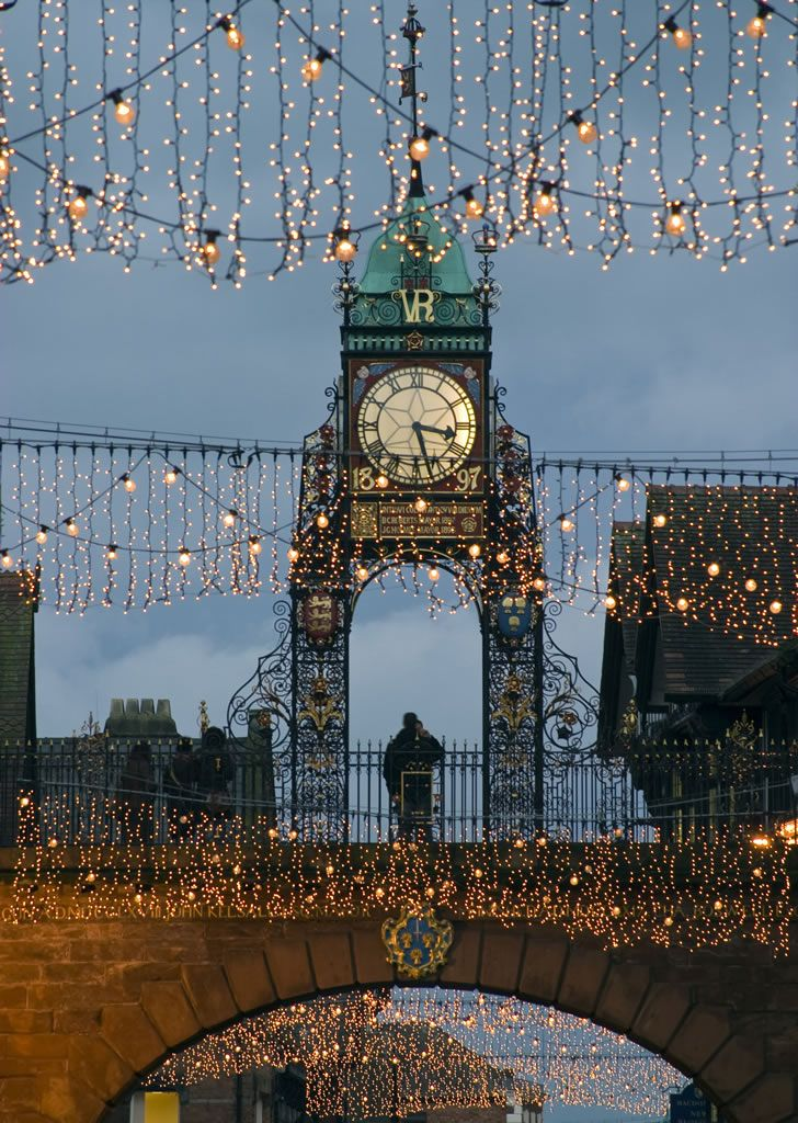 Chester, England ~ clock framed in Christmas lights.. Our tips for 25 fun things to do in England: http://www.europealacarte.co.uk/blog/2011/08/18/what-to-do-england/