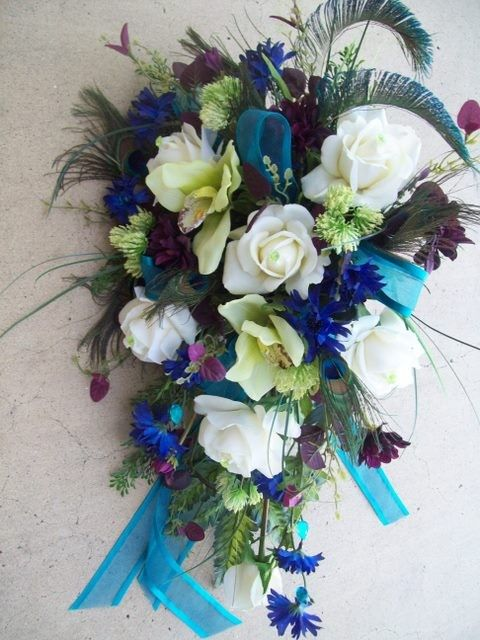 Royal Peacock Wedding Flowers Bridal Bouquet Real Touch Roses and Orchids TeaL, PLuM, BLue, aND GReeN WeDDiNG FLoWeRS. $169.00, via Etsy.