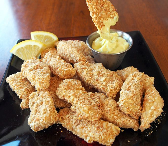 Baked Walleye Fingers served in a cup with fries and tarter sauce.  WI Fresh water fish