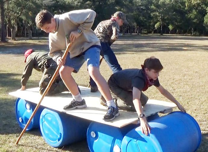 "Exampling great teamwork during the ""Lizzy Gator"" patrol challenge at a District Camporee! http://scoutpioneering.com/2014/11/17/pioneering-and-team-building/"