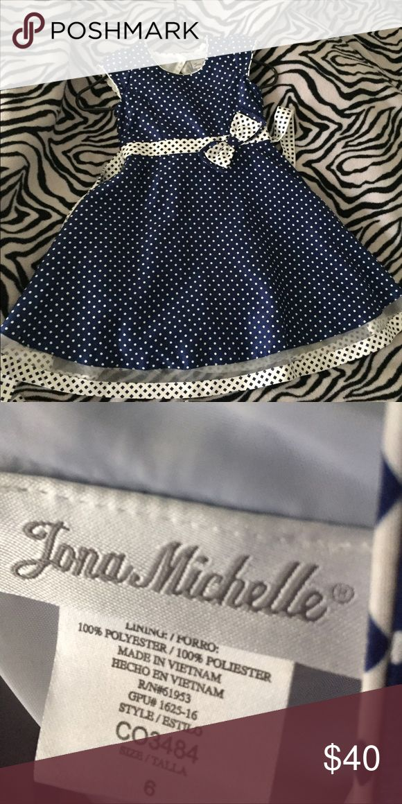 Little Girl Formal Dress Navy blue and white polka dot dress. Worn once for birthday party. Has built in belt that ties in the back. Size 6. Jona Michelle Dresses Formal