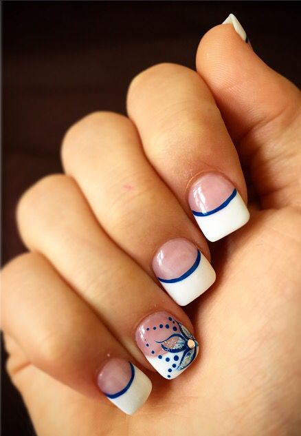 Acrylic French Tip Nails with blue designs for prom to accent a royal blue dress!!