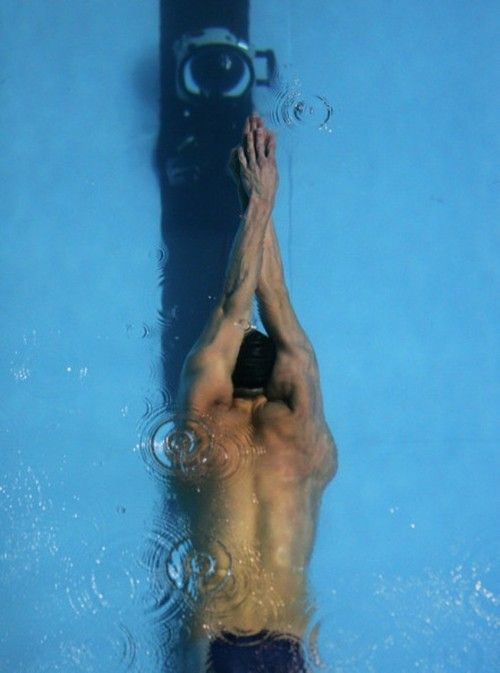 Did you know that Noah Adams was a swimmer like Michael Phelps? He'd have given the Olympic champ a run for his money if it hadn't been for his pesky appendix. This pic of MP is how I envision Noah the first time Catie sees him swim at the BU pool.