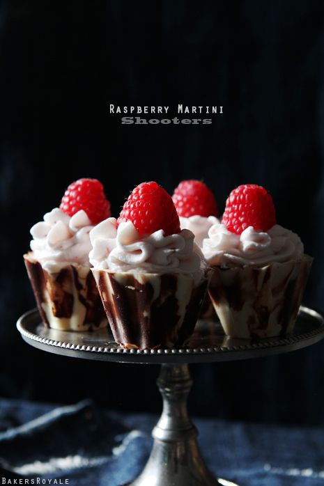 Raspberry Martini Shooters  •6oz white chocolate, melted (about 1 cup)  •3 oz dark chocolate, melted (about 1/2 cup)  •1 1/2 cup heavy cream, cold  •1/2 cup confectioner sugar  •1/2 cup vodka  •4 oz raspberries, pureed