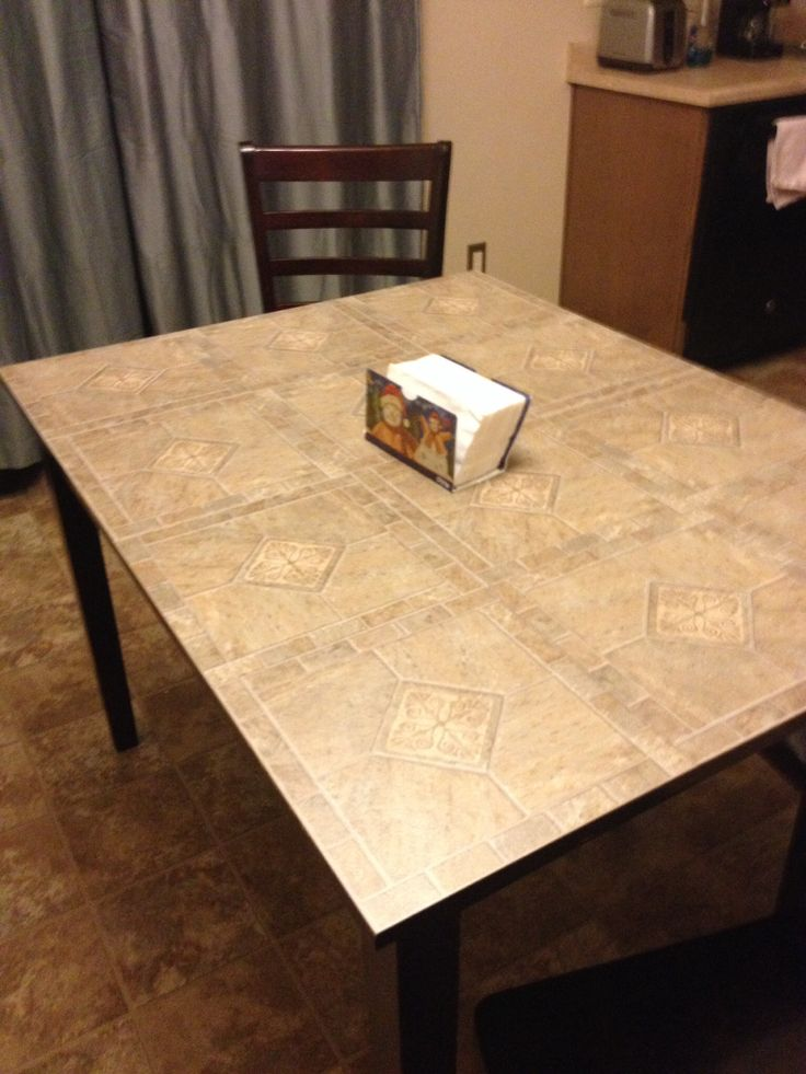 Best idea ever! Self adhesive floor tiles to redo the table.